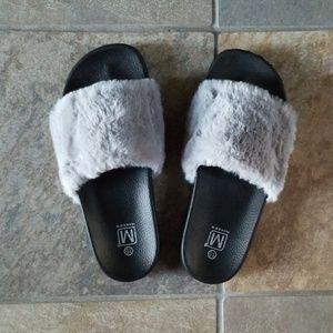 Brand new!! Fuzzy Slippers